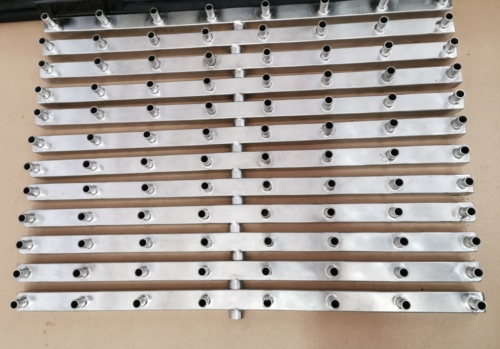 Stainless steel manifold with 8 outlets.