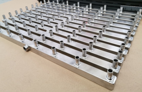 Stainless steel manifolds with 8 outlets.